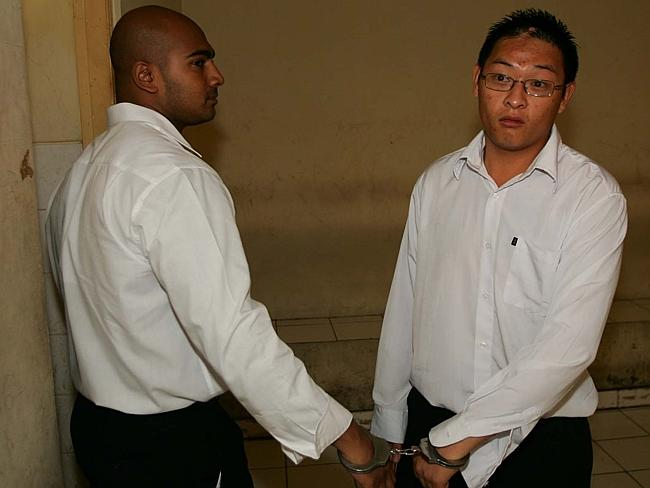 Australians on death row ... Myuran Sukumaran and Andrew Chan inside a holding cell.