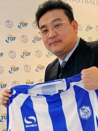 Dejphon Chansiri holds a Sheffield Wednesday shirt. He ran a consortium that bought the c