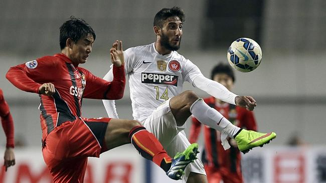 Kerem Bulut, right fights for the ball with Lee Woong-hee.