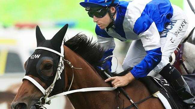 Tommy Berry wins race 9 on Permit during Golden Slipper Day at Rosehill Races. Picture: M