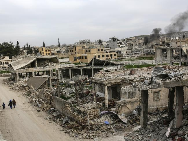 A neighbour in ruins ... the Syrian town of Kobane, pictured on March 27, 2015. Picture: