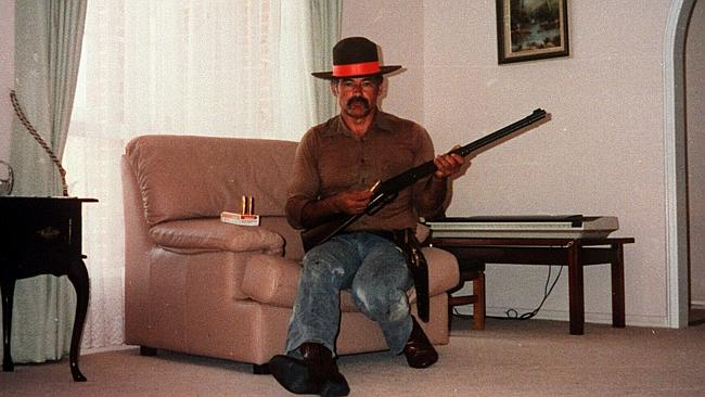 Sickening ... Ivan Milat wears a sheriff's badge as he poses in his lounge room with fire
