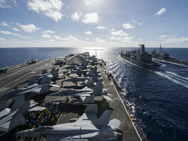 Team America ... The United States is repositioning more warships, aircraft and troops in
