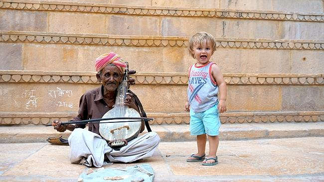 Jack with a street performer in India.