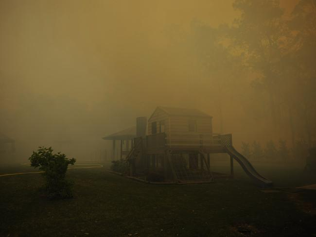 A children's cubby house and play set are choked by smoke in Bligh Park. Picture: Rogers Phil