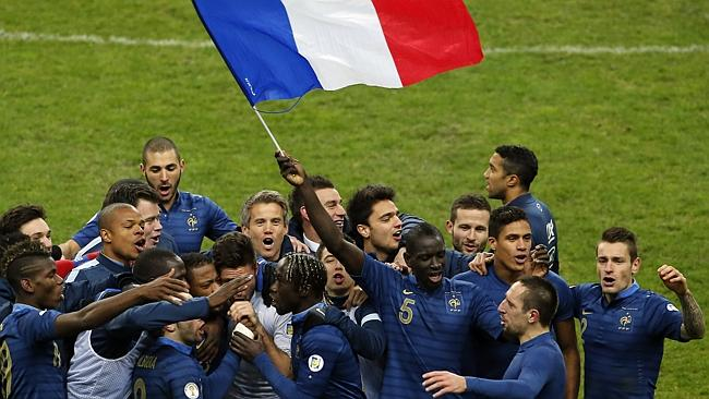 France's soccer team celebrate after defeating Ukraine.