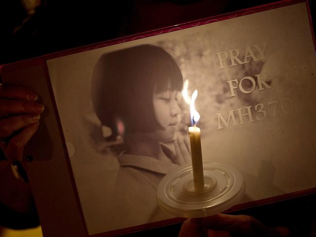 Vigil ... people in Kuala Lumpur are praying for a miracle.