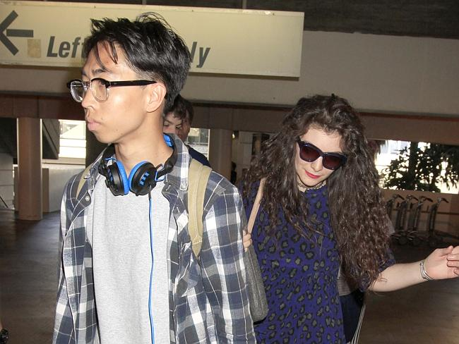 Lorde and her boyfriend James Lowe as they arrive in Los Angeles.
