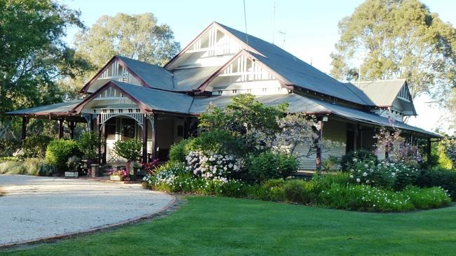 Booabula Station's Federation-style homestead is set against the native timber of the Billabong Creek.