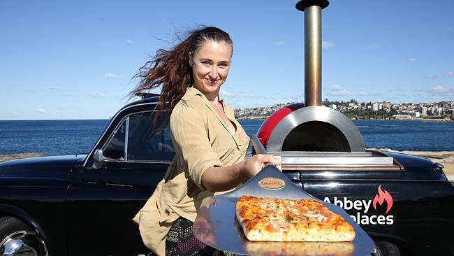 Lucia Del Prete with her London cab which has been converted into a mobile wood-fired piz