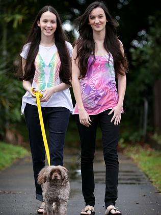 BATTLE: Cairns sisters, Elyshia, 18 and Emily Hicky, 15, both have a rare connective tiss