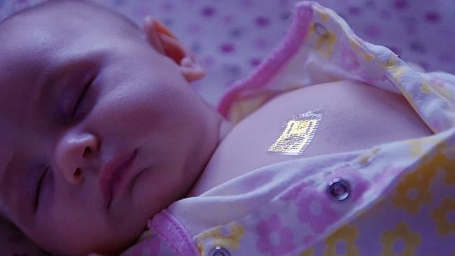 A baby is monitored by MC10's Biostamp electronic tattoo.