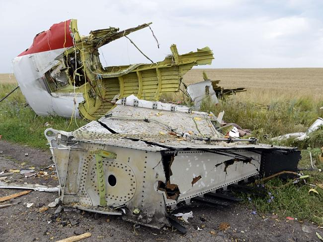 Where are the bloc boxes? ... Debris lies at the site of the crash of Malaysia Airlines p