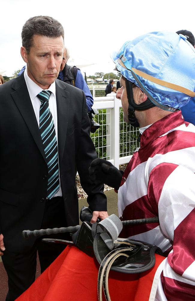 Trainer Darren Bell speaks to Larry Cassidy after Falino's victory. Picture: Darren Engla