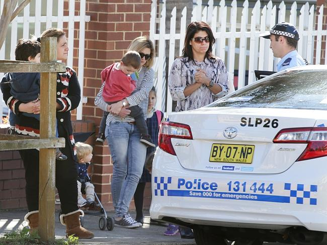 Police talk with parents outside Maronite College of the Holy Family in Harris Park. Pict