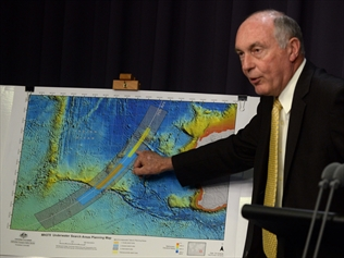 Warren Truss with a search map for missing flight MH370