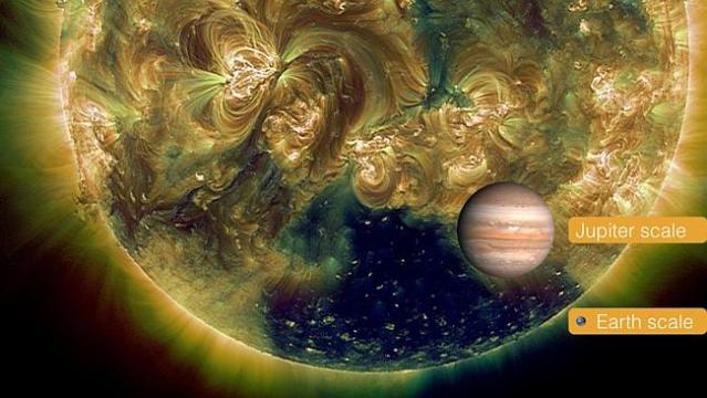 This photo of Earth and Jupiter gives a sense of the size of the coronal hole.
