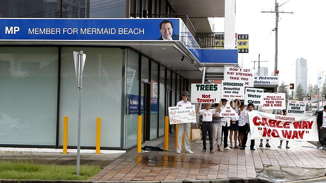 Opponents of the cableway project stage a pop-up rally outside the electorate office of M