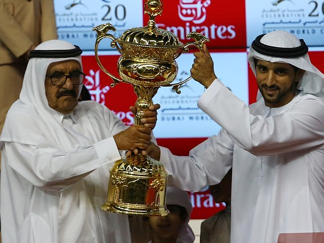 Sheikh Hamdan Bin Rashid al-Maktoum receives the winners trophy.