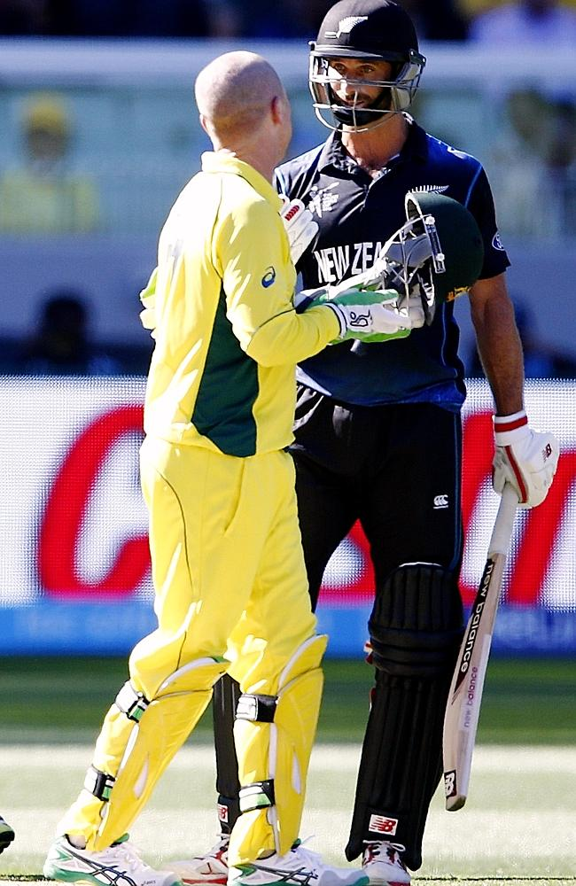 The eyes have it. Grant Elliott's intense stare at Brad Haddin tell its own story.