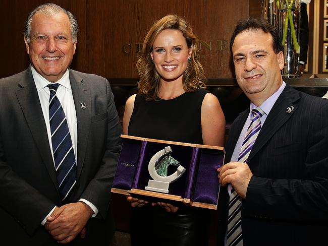 Francesca Cumani unveils the 2015 official trophy for The Championships with John Messara