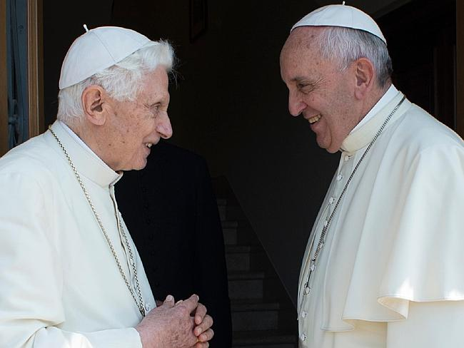 Sharing ideas? ... Pope Francis (R) speaks with Pope Emeritus Benedict XVI at the Vatican