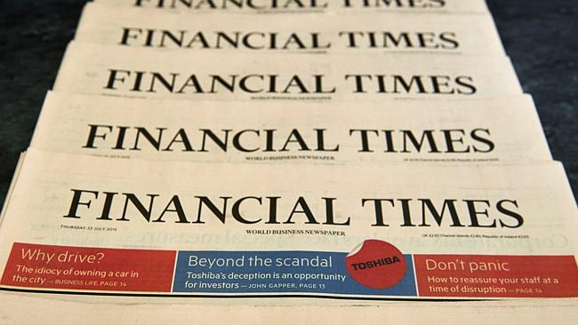 Copies of the July 23, 2015 edition of the Financial Times newspaper are displayed for a