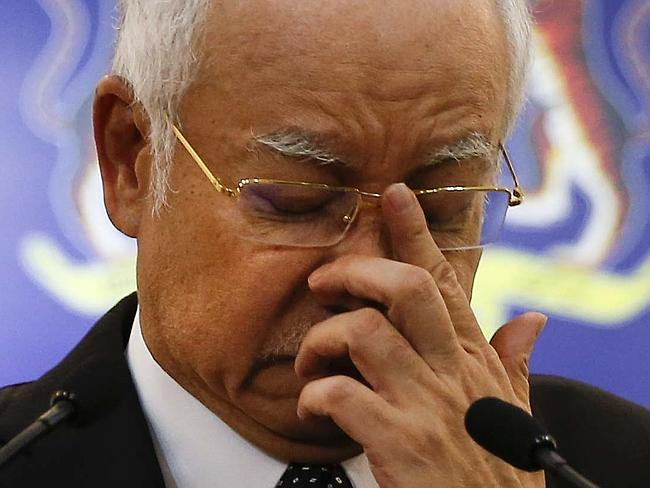Announcement ... Malaysian Prime Minister Najib Razak, gestures as he speaks at a special
