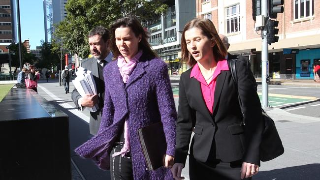 Gerard Baden-Clay's sister Olivia Walton (centre) arrives at court with defence lawyers P
