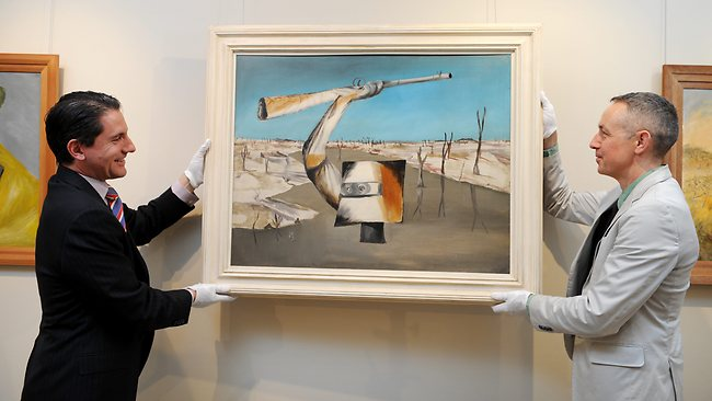 Geoffrey Smith and Brett Ballard pictured with Sidney Nolan's Ned Kelly: Crossing the River