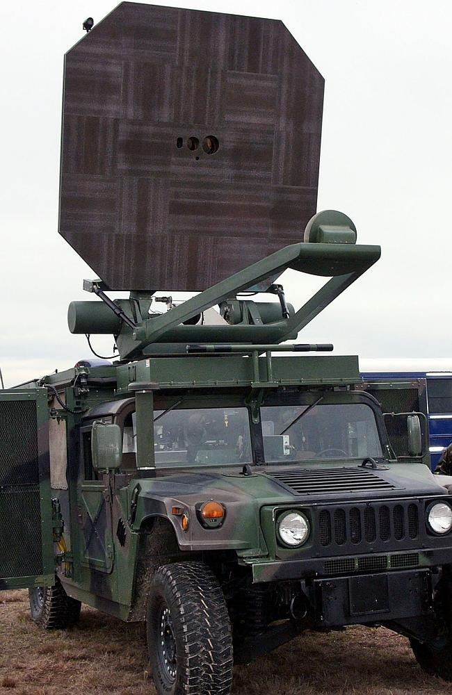 A US Marine Corps truck carries an Active Denial System. It is a nonlethal weapon that uses directed energy and projects a be...