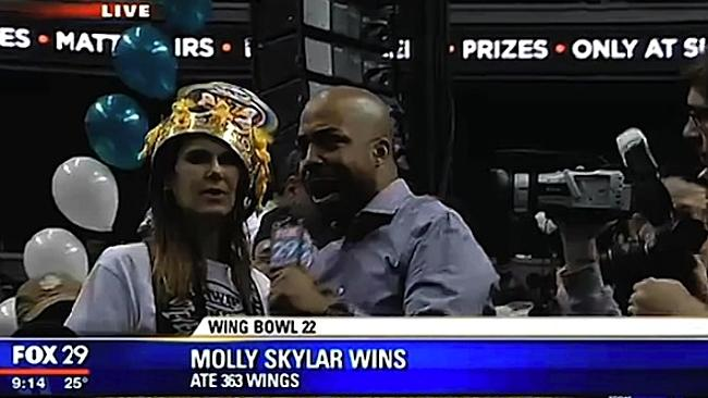 Gutsy effort ... Wing Bowl 22 winner Molly Skylar ate 363 wings in 30 minutes.
