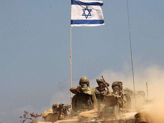 No surrender ... An Israeli flag flutters atop an armoured personnel carrier (APC) carryi