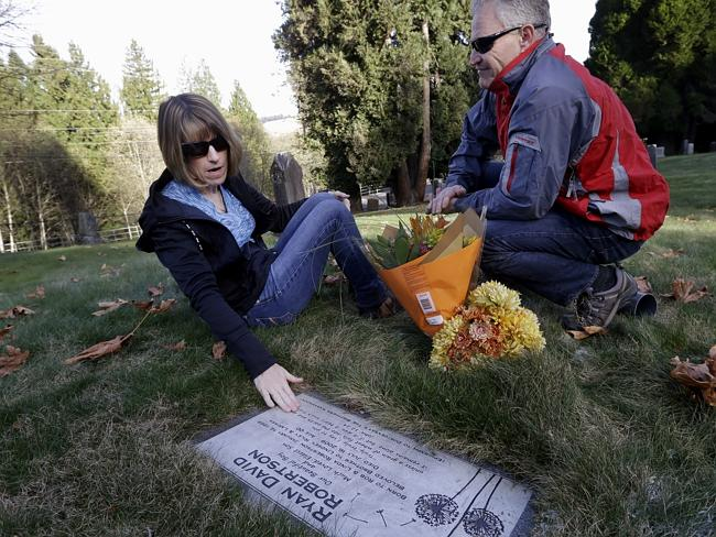 Now we just visit his gravestone ... Linda and Rob Robertson visit the grave of their son