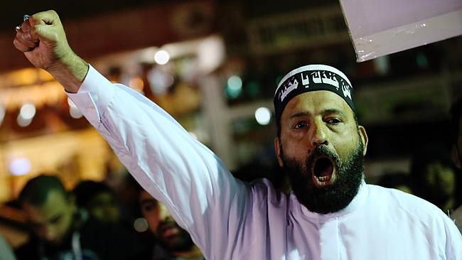 NOT JUST A CRACKPOT: Sheik Man Haron Monis's protest at Lakemba train station.