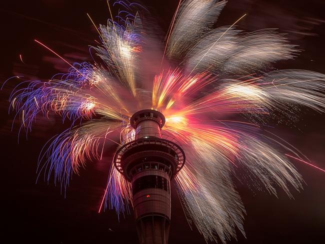 Resplendent ... fireworks explode from the top of Sky Tower in Auckland, New Zealand. Pic