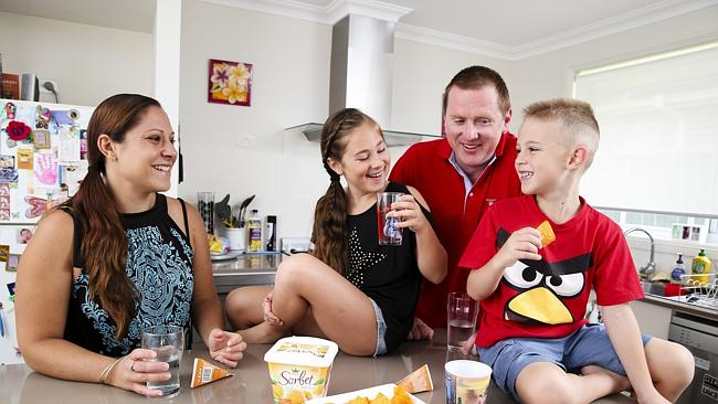 Gareth and Nicole Timbs at their airconditioned home with their children Alissa, eight, a