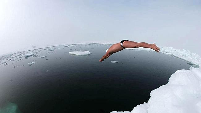 Incredible feat ... British explorer and endurance swimmer Lewis Gordon Pugh dives into t