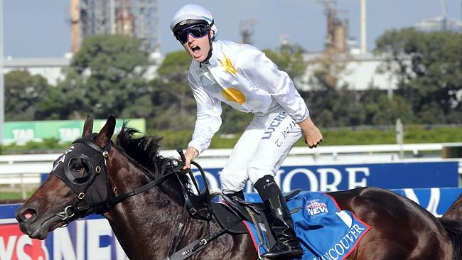Tommy Berry celebrates winning the Golden Slipper on Vancouver.