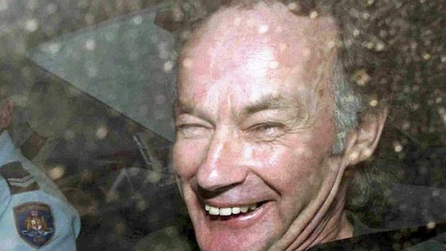 Chilling ... a smiling Ivan Milat leaves court.