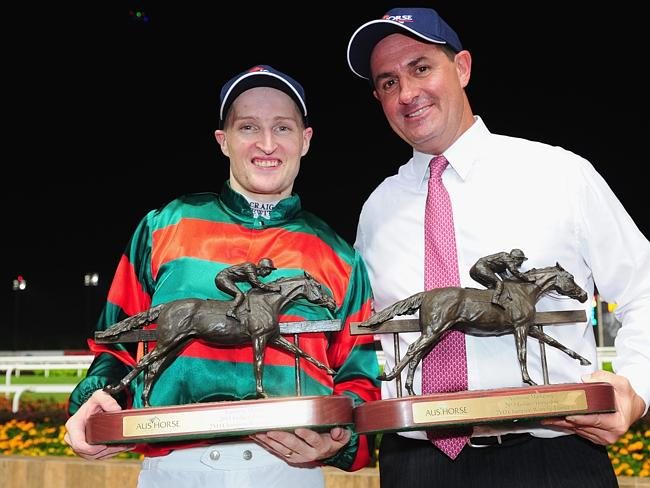 Craig Newitt and trainer Michael Freedman pose with their trophies after winning the Grou