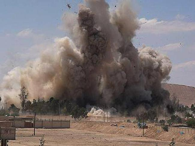 Blast ... smoke rises at Tadmur prison after being blown up and destroyed by the Islamic