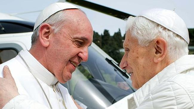 Retiring type? ... Pope Francis, pictured with Pope Benedict, says no positions in the Ca