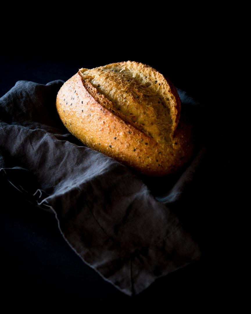 Artisan bread on dark napkin with black background