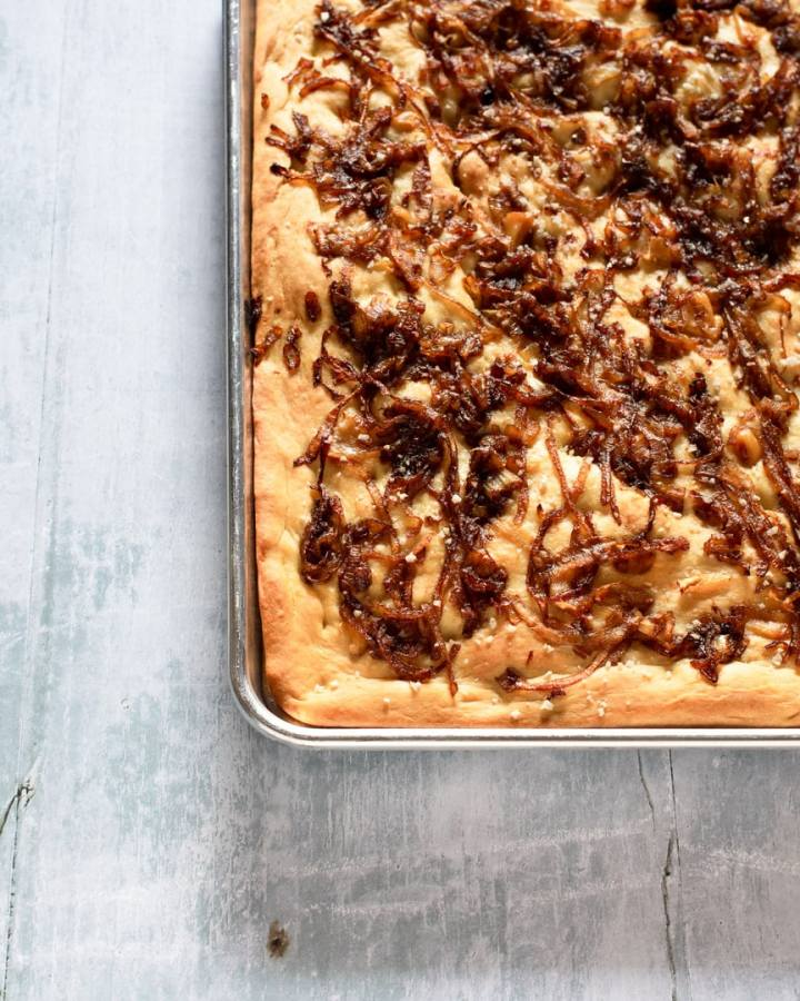 tray of foccacia with caramelized onion and garli