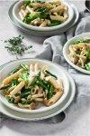 asparagus mushroom pasta with fresh thyme on 3 plates 3/4 angle