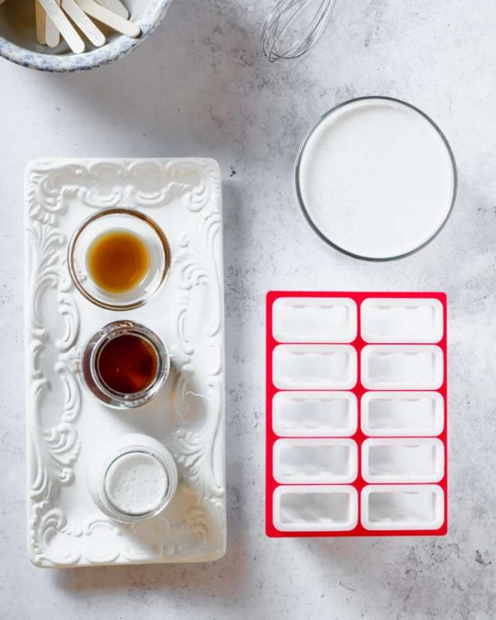 white tray with vanilla, maple syrup and coconut milk