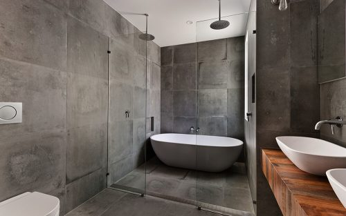 Gray bathroom with natural wood accent