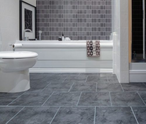 Bathroom with gray floor tile