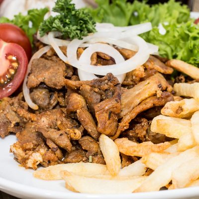 Fresh Chips with Kebab meat on wooden background